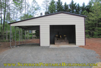 Steel garage with lean to.